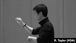 """Conductor Chen Lin rehearses """"Luan Tan"""" by composer Chen Qigang at The Juilliard School."""