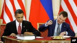 "U.S. President Barack Obama and Russian President Dmitry Medvedev sign START treaty in 2010. (File) ""Implementation is going smoothly behind the scenes,"" said Ms. Gottemoeller."