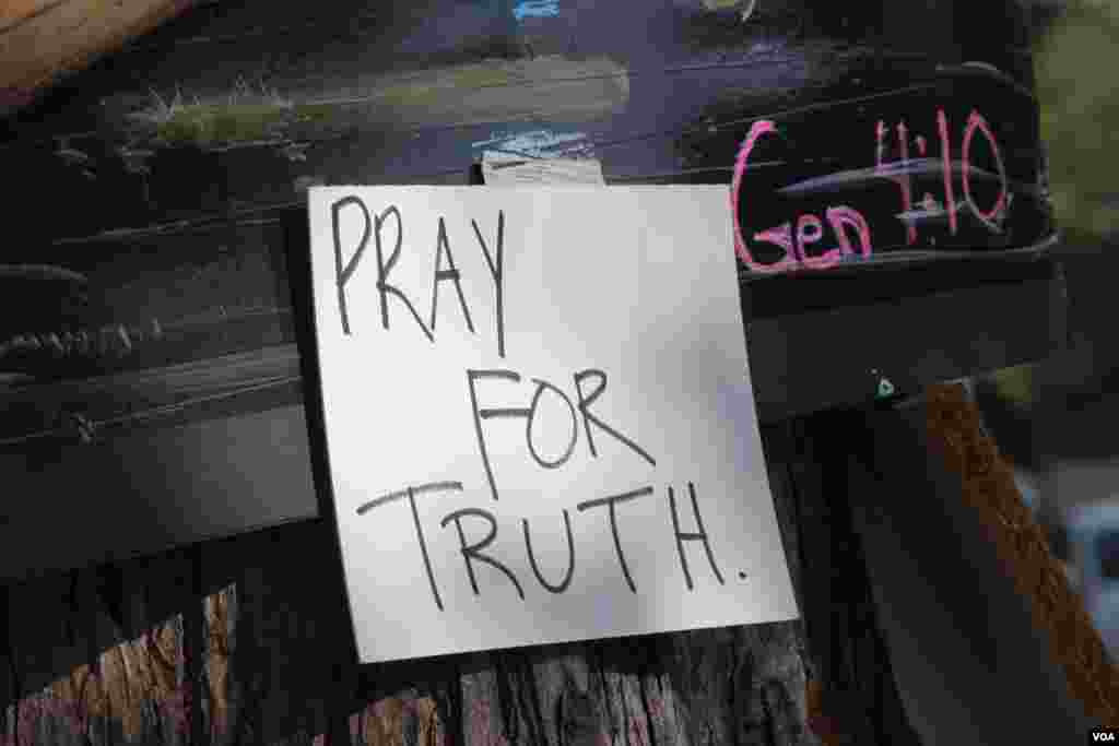 A sign in Ferguson, Missouri, after the shooting death of Michael Brown, Aug. 24, 2014. (Gesell Tobias/VOA)