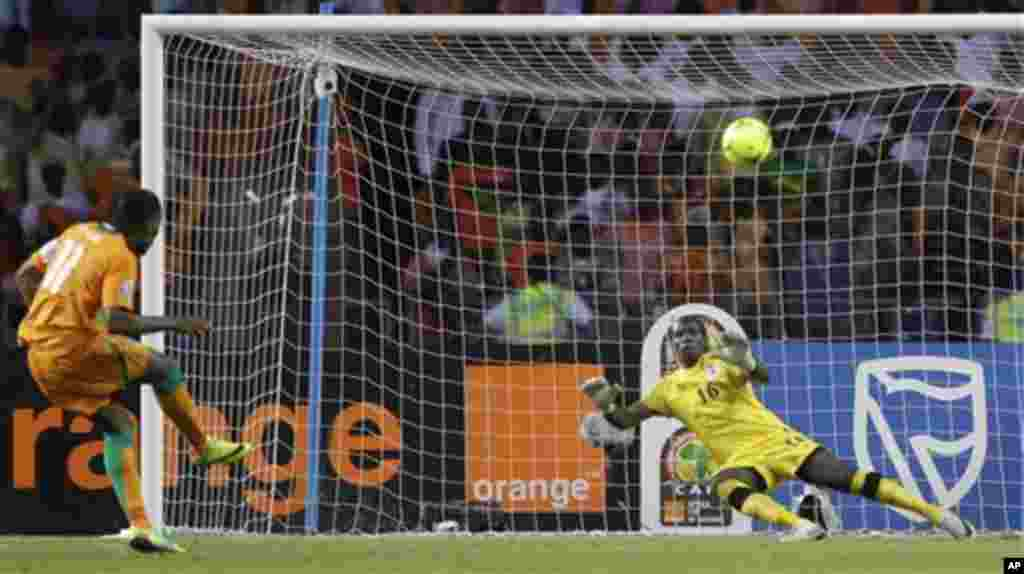 Ivory Coast's captain Didier Drogba, left, makes a penalty shootout against Zambia's goalkeeper Kennedy Mweene during their Africa Cup of Nations final soccer match at the Stade de l'Amitie in Libreville, Gabon, Sunday Feb. 12, 2012.