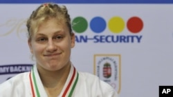 Kayla Harrison of the U.S. smiles after winning the gold medal in the women's under 78 kg category final match at the World Cup Judo tournament in Budapest, Hungary, February 12, 2012.