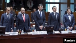 European Council President Donald Tusk (L-R), European Parliament President Martin Schulz, EU Council General-Secretary Corsepius, Italian PM Renzi and Greek PM Tsipras observe a minute of silence during a EU extraordinary summit in Brussels, April 23, 2015