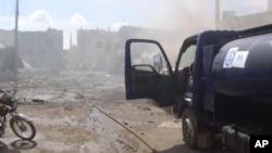 Hiện trường sau các cuộc không kích của Nga ở Talbiseh, Syria, ngày 30/9/2015.