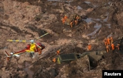 Rescue crew work in a tailings dam owned by Brazilian miner Vale SA that burst, in Brumadinho, Brazil, Jan. 25, 2019.