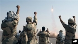 FILE - Iranian Revolutionary Guards celebrate after a missile is launched in Iran, July 3, 2012. Kurdish rebels on Friday clashed with Iran's Revolutionary Guards for a second consecutive day in a border area between Iraq and Iran.