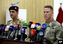 U.S. Army Col. Ryan Dillon, spokesman for Operation Inherent Resolve, the U.S.-led coalition against the Islamic State group, right, and Iraq armed forces spokesman Gen. Yahyah Rasul hold a press conference in Baghdad, Iraq, Thursday, Sept. 21, 2017.