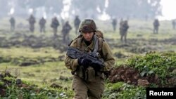 An Israeli soldier from the Golani brigade takes part in training near the city of Katzrin in the Golan Heights, Jan. 19, 2015.