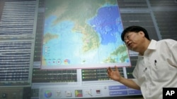 FILE - In this Aug. 28, 2006, photo, Heon-Cheol Chi, of the Korea Earthquake Research Center, explains his concerns of a possible nuclear test in North Korea in Daejon, South Korea.