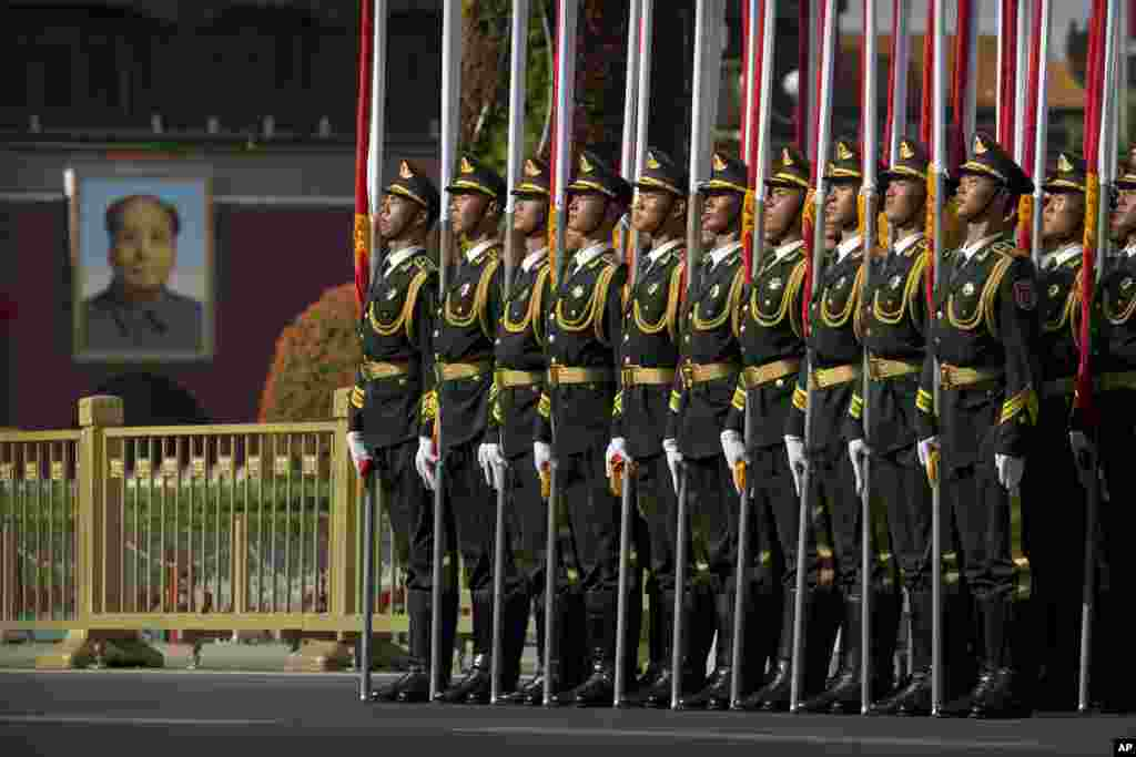 Members of a honor guard line up in formation near a large portrait of Chinese leader Mao Zedong on Tiananmen Gate before a welcome ceremony for Kazakhstan's President Nursultan Nazarbayev at the Great Hall of the People in Beijing.
