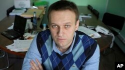 In this March 17, 2010 file photo, corporate Russian lawyer Alexei Navalny poses in his office in Moscow, Russia. (AP Photo/Alexander Zemlianichenko, file)