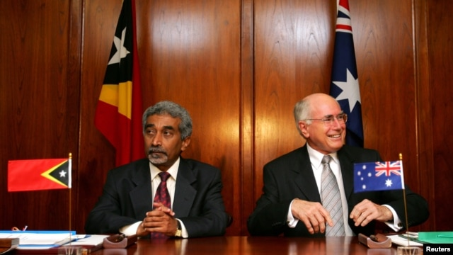 FILE - Australian Prime Minister John Howard (R) and his East Timorese counterpart Mari Alkatiri sit together in Sydney as they await a signing ceremony for the Treaty on Certain Maritime Arrangements in the Timor Sea, Jan. 12, 2006.
