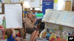 Teacher Laurie Gerard uses iPads with her kindergarten students in Auburn, Maine.