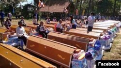 Forty coffins were given to aging villagers in a ceremony, where they were placed in a line, Samki commune in Kampong Thom province was photographed early this month​​ and went viral on social media Facebook. (Facebook)