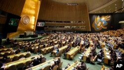 FILE - People gather at the General Assembly, prior to a vote, Dec. 21, 2017, at United Nations headquarters in New York.