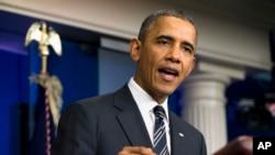 奥巴马总统于2013年9月27日在白宫发表有关联邦预算谈话的照片。
