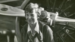 Amelia Earhart with her Lockheed Vega airplane