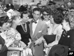 "A young Frank Sinatra, surrounded by fans at about the time he recorded ""It Might As Well Be Spring"""