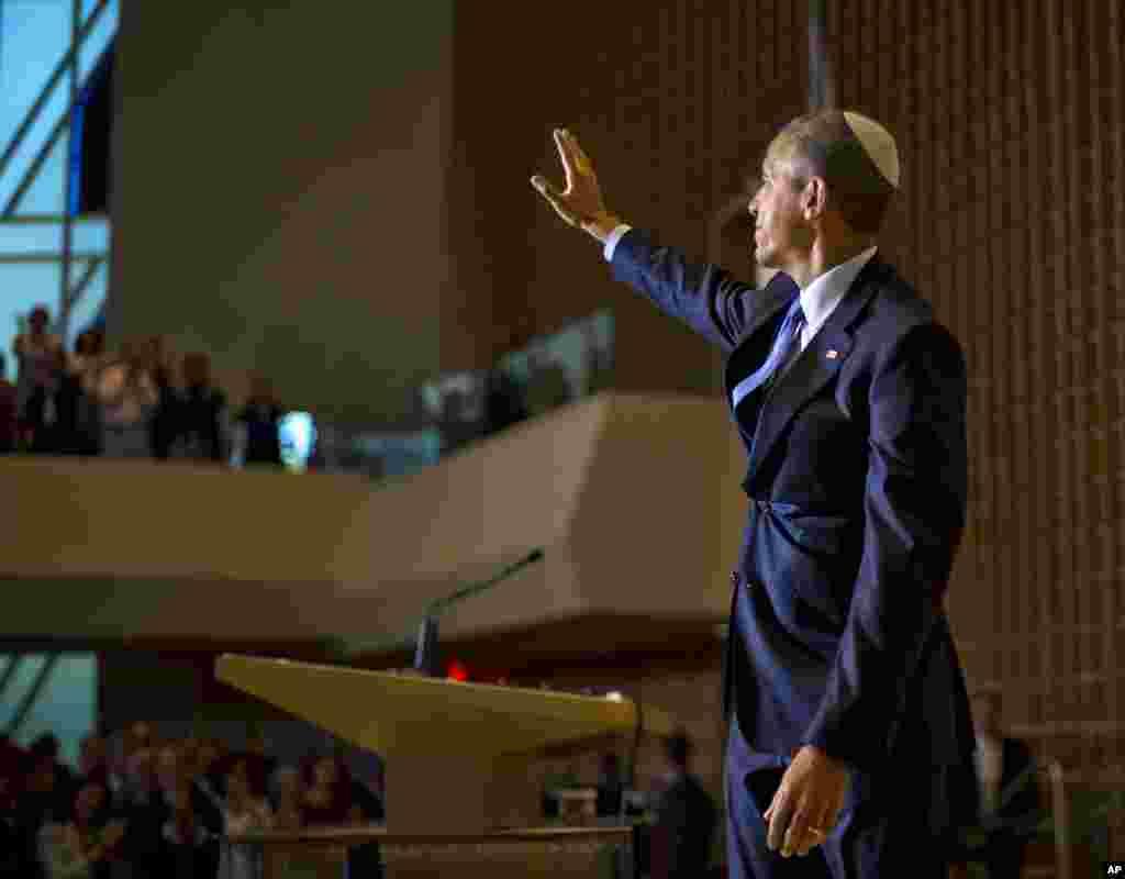 President Barack Obama, wearing a traditional Jewish yarmulke, waves after speaking at Adas Israel Congregation as part of Jewish American Heritage Month, in Washington, May 22, 2015.