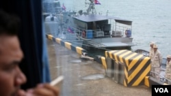 FILE: A journalist looks out from a bus over a jetty mooring patrol boat during a rare media tour at Ream Naval Base in Preah Sihanouk province, Friday, July 26, 2019. (Sophat Soeung/VOA Khmer)