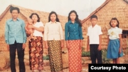 The Mells posed for a family photo in Thailand's Khao I Dang refugee. (Courtesy of Sameth Mell)