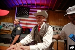 Former Alabama chief justice and U.S. Senate candidate Roy Moore shakes hands with supporters after speaking at a rally, in Fairhope, Alabama, Sept. 25, 2017.