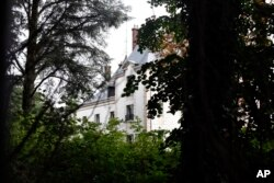 FILE - The manor of Bashar al-Assad's uncle, Rifaat al-Assad, is seen, in Bessancourt, north of Paris, Sept. 13, 2013. The manor whose real estate portfolio in the Paris region alone is estimated at Euros 160 million. A property in London, once owned by Rifaat al-Assad, was sold before it could be seized by authorities.