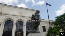 The Thinker, by Rodin, is displayed outside the Detroit Institute of Arts in Detroit, Michigan.
