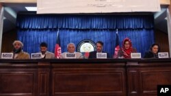 Leaders of the Afghan People's Dialogue on Peace Initiative address a press conference in Kabul, Afghanistan, Saturday, Jan. 9, 2016. Afghanistan, Pakistan, China and the United States will hold talks in Islamabad on Monday aimed at reviving the Afghan pe