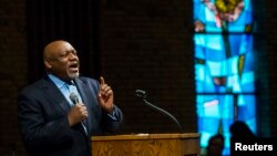 Pastor Tommie Pierson preaches during a Thanksgiving service that discussed the reaction in Ferguson, Missouri, to developments in the Michael Brown case, Nov. 27, 2014.