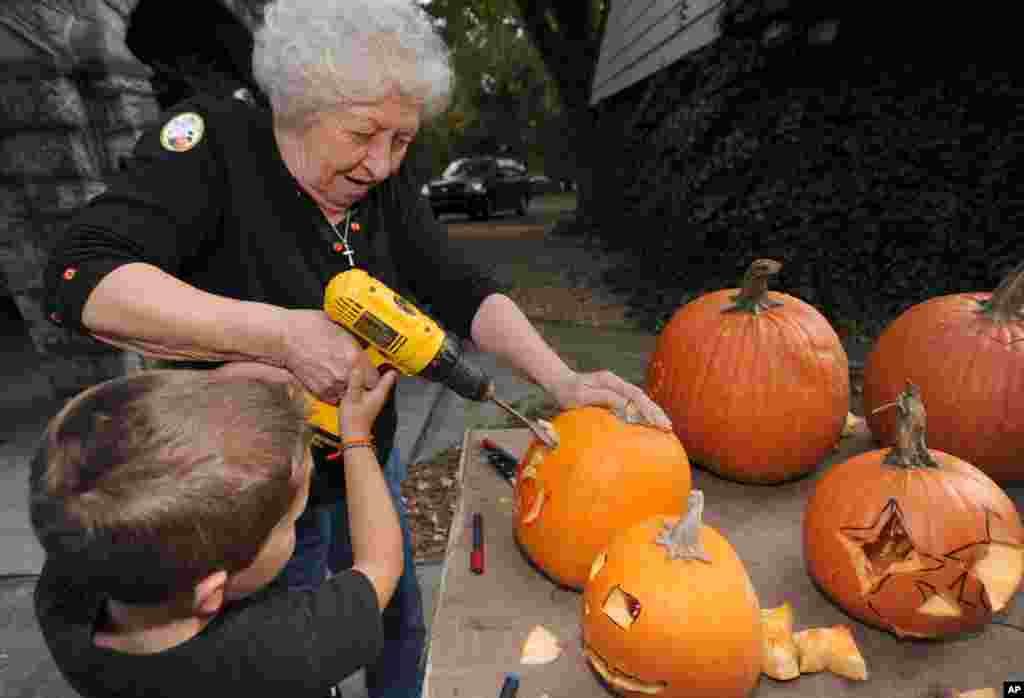 Betty Dillow helps her grandson Judge with his pumpkin carving in Bristol, Va.