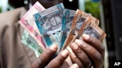 To buy dollars with South Sudanese Pounds (SSP) at the official exchange rate of 3.16 to the dollar, people have to go to the Central Bank in Juba. The black market rate is about 9 SSP to $1.