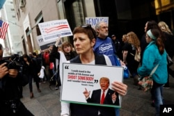 """Protesters, organized by The Brady Campaign to Prevent Gun Violence, stage a """"die-in"""" in front of Trump Tower, the residence of Republican presidential candidate Donald Trump, March 16, 2016, in New York."""