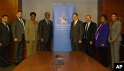 MCC Ceo Daniel Yohannes (center left) greeting ambassadors from around the world