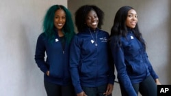 Members of the Nigerian women's bobsled team (L-R), Akuoma Omeoga, Seun Adigun and Ngozi Onwumere, pose for a photograph during an interview with The Associated Press at the 2018 Winter Olympics in Pyeongchang, South Korea, Tuesday, Feb. 13, 2018.