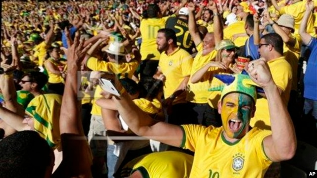 Brazil soccer fans celebrate their team's victory over Chile after a penalty shootout at a World Cup round of 16 match, Mineirao Stadium, Belo Horizonte, June 28, 2014.