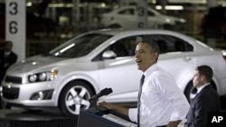 President Barack Obama speaks at the General Motors Orion assembly plant in Orion Township, Michigan, October 14, 2011.