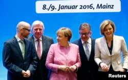 German Chancellor and leader of the Christian Democratic Union (CDU) Angela Merkel arrives with her deputy party leaders for the start of a two-day CDU party leadership meeting in Mainz, Germany, Jan. 8, 2016.