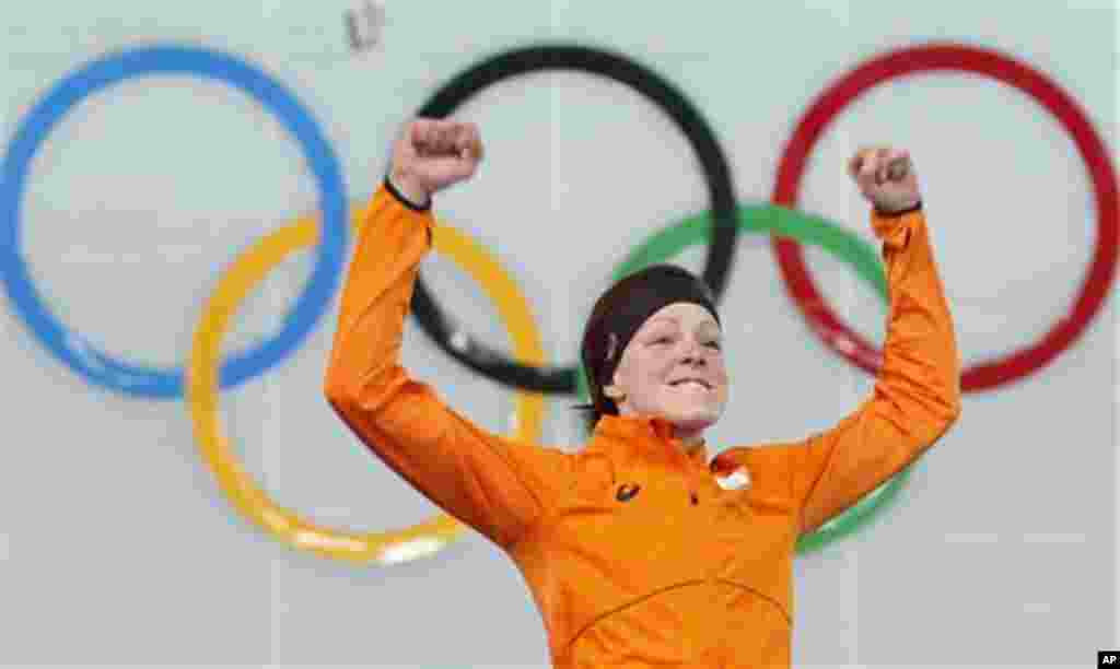 Gold medallist Jorien ter Mors of the Netherlands jumps in celebration during the flower ceremony for the women's 1,500-meter speedskating race at the Adler Arena Skating Center during the 2014 Winter Olympics in Sochi, Russia, Sunday, Feb. 16, 2014. (AP