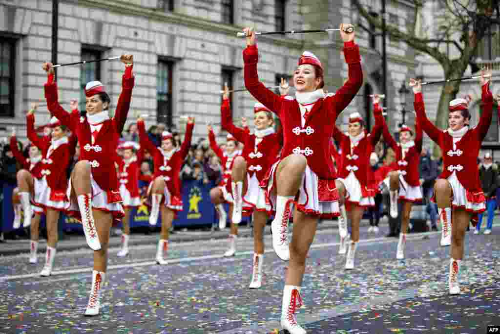 Participants take part in the annual New Year's Day Parade in central London.