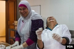 Though it was not easy at first, cooking together has helped women from the Bab Al-Tebbeneh and Jabal Mohsen bond, December 2014. (J. Owens / VOA)