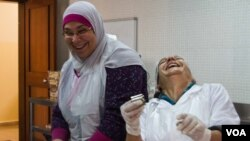 These Lebanese women are from two religious communities (the Bab Al-Tebbeneh and Jabal Mohsen) and should be enemies. But don't tell them that. They are too busy making money for their families, peace for their communities and just having fun together, December 2014. (J. Owens / VOA)