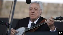 FILE - In this July 30, 2011 file photo, Earl Scruggs performs at the Newport Folk Festival in Newport, Rhode Island. Scruggs performed at the original festival 52 years ago.