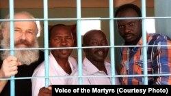 Pastor Hassan Abduraheem, second from left, is shown in prison in Sudan.