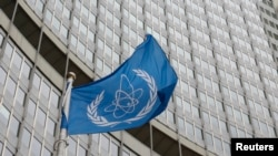 FILE - The flag of the International Atomic Energy Agency (IAEA) flies in front of its headquarters in Vienna, Austria, Jan.15, 2016.