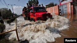 A truck evacuating Kashmiri flood victims to higher ground travels through a flooded street in Srinagar, Sept. 10, 2014.