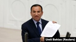 FILE - Justice Minister Bekir Bozdag addresses the Turkish Parliament during a debate in Ankara, March 19, 2014. Bozdag disclosed a plan on April, 6, 2016, to strip citizenship from Turks found to be supporting terrorism.