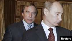 FILE - Russian cellist and Putin associate Sergei Roldugin (L) is seen with Vladimir Putin, prime minister at the time, at the House of Music in St. Petersburg, Russia, Nov. 21, 2009. Roldugin is among Russians named in the Panama Papers.