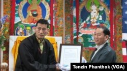 Kunga Thinley (left) and Lobsang Nyandak (right)