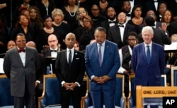 From left, Louis Farrakhan, the Rev. Al Sharpton, the Rev. Jesse Jackson and former President Bill Clinton attend the funeral of Aretha Franklin at Greater Grace Temple, Aug. 31, 2018, in Detroit.