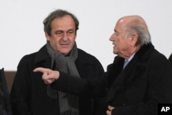FILE - UEFA president Michel Platini (L) and FIFA president Sepp Blatter are seen in a Dec. 16, 2014, photo.
